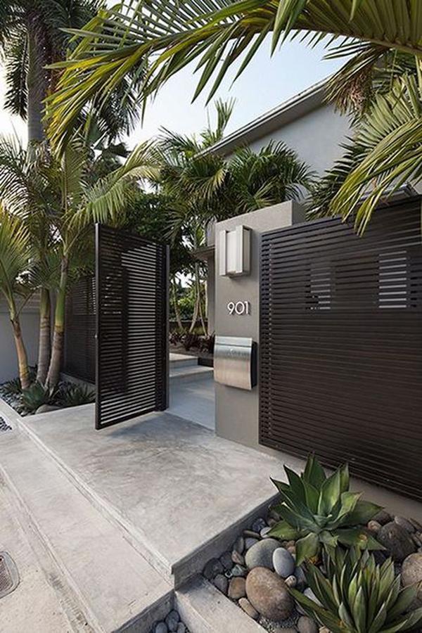 desain-pagar-besi-hollow-minimalis-dengan-warna-hitam